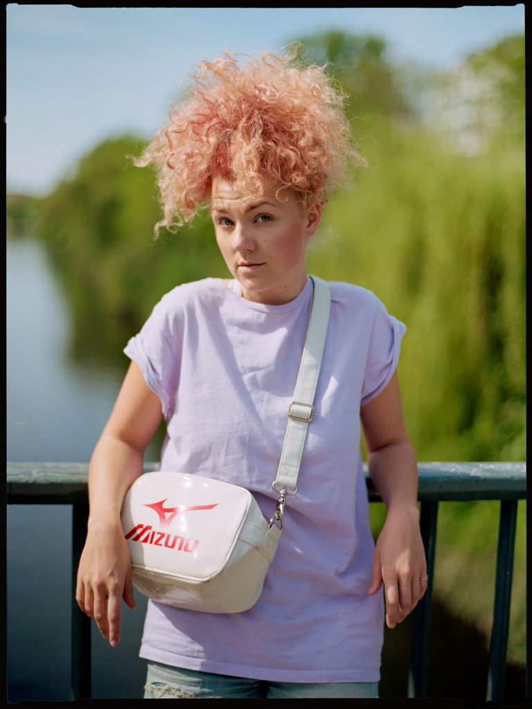 Gorgeous Strawberry Blonde Hair meets lavender t-shirt on the Hobrechtbrücke in Kreuzberg