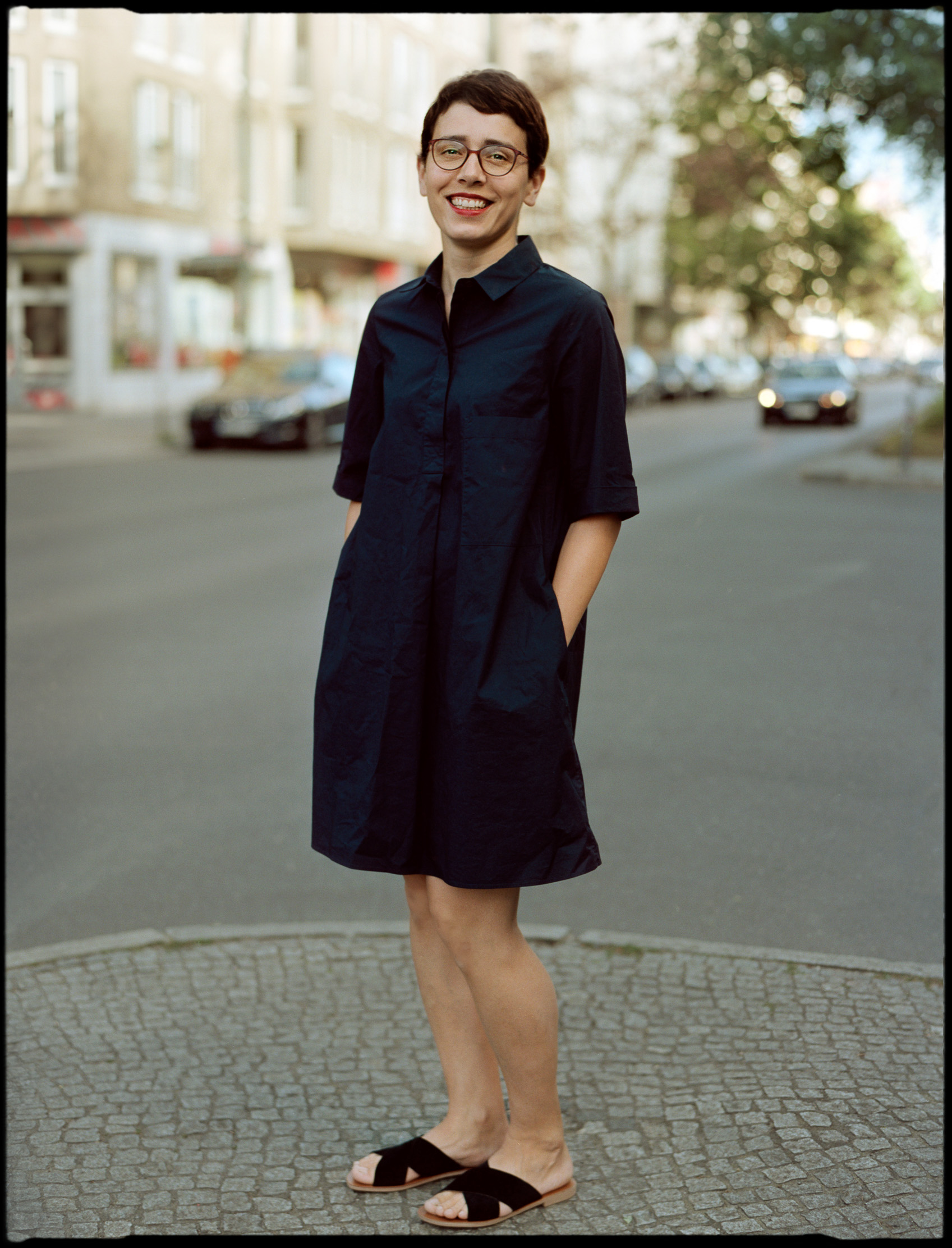 berlin street style woman in the coss dress