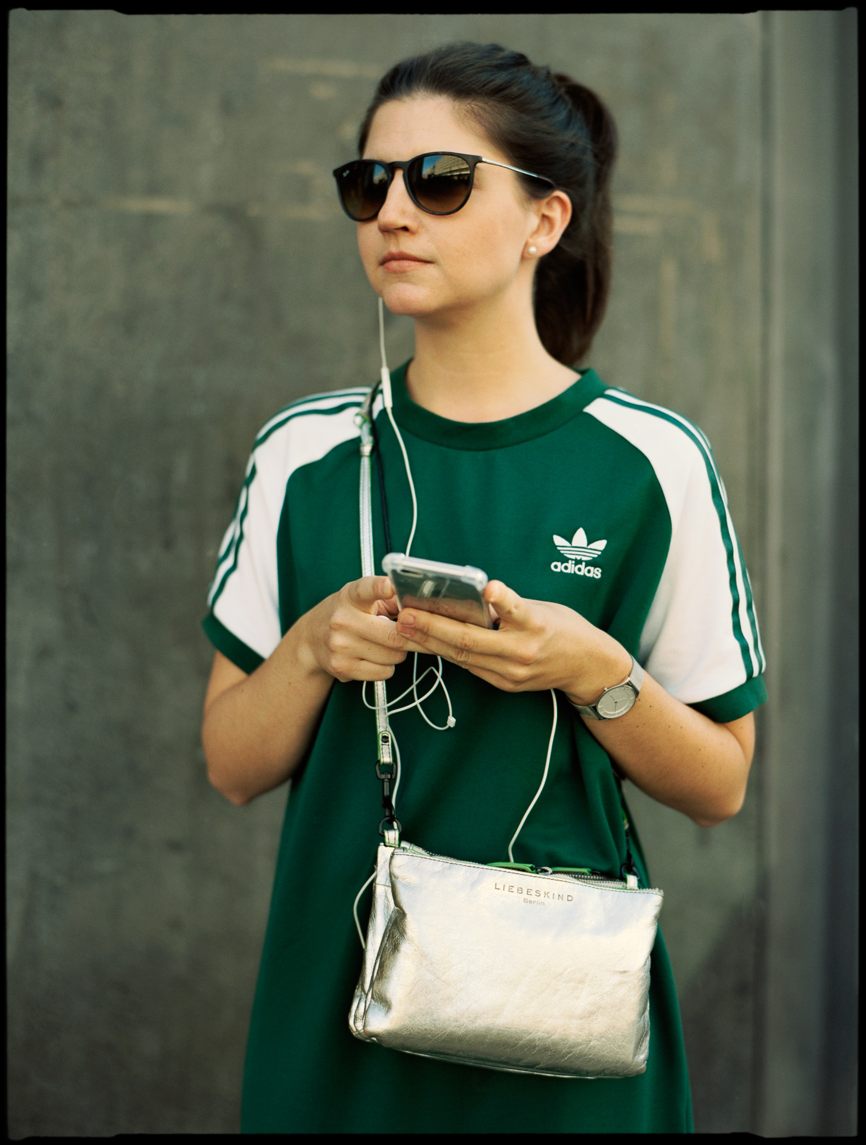woman in an adidas dress