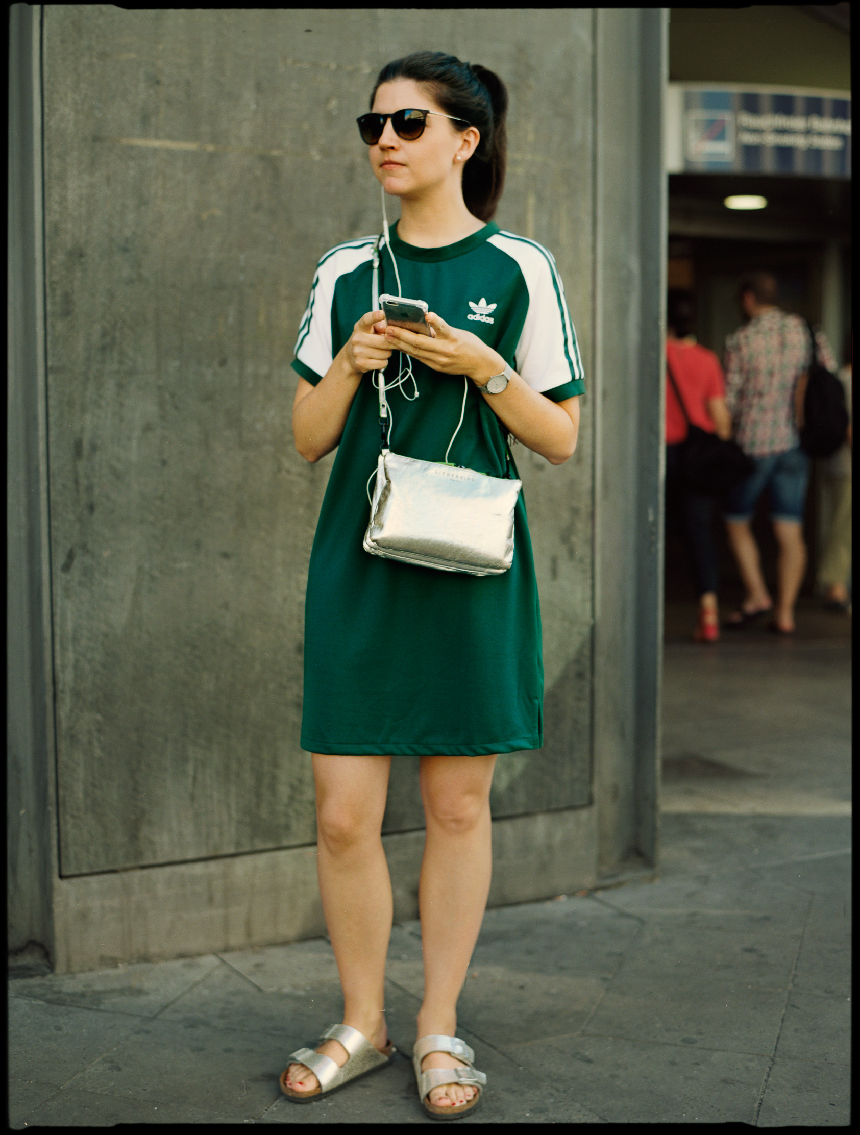 Woman in an adidas dress with a silver bag